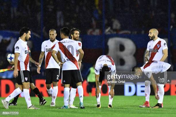Players of River Plate look dejected after a match between Tigre and River Plate as part of Superliga 2017/18 at Jose Dellagiovanna Stadium on...