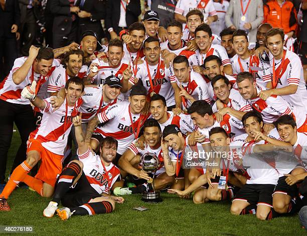 Players of River Plate pose for a group photo after winning the second leg final match between River Plate and Atletico Nacional as part of Copa...