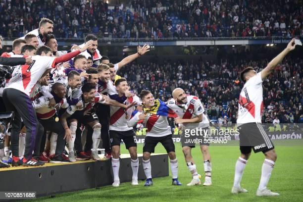 Players of River Plate pose for a selfie after winning the second leg match of the allArgentine Copa Libertadores final against Boca Juniors at the...