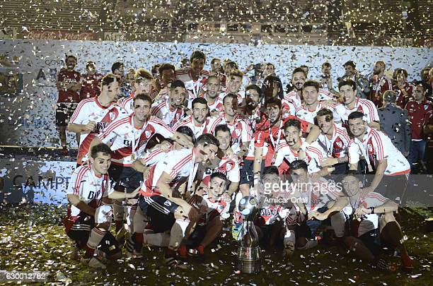 Players of River Plate pose for a team photo with the trophy after a final match between River Plate and Rosario Central as part of Copa Argentina...