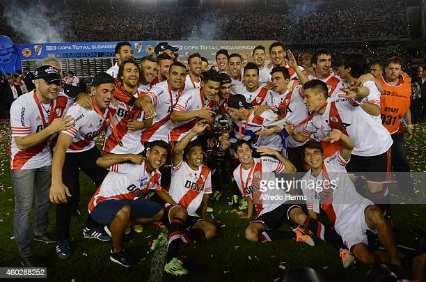Players of River Plate pose for a team picture after winning a second leg final match between River Plate and Atletico Nacional as part of Copa Total...