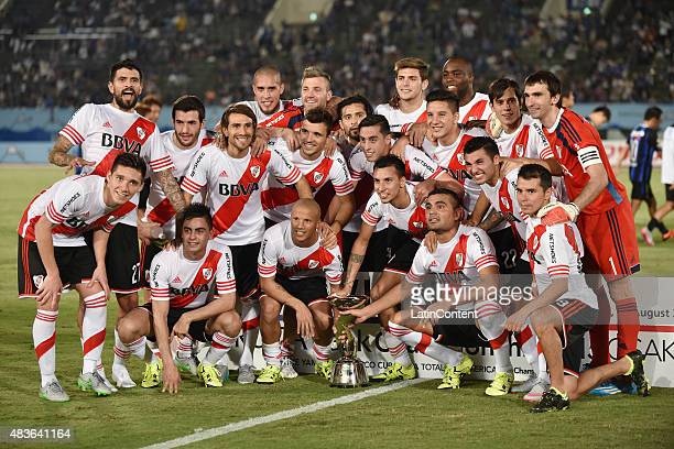 Players of River Plate pose for pictures with the trophy after winning a match between Gamba Osaka and River Plate at Osaka Expo '70 Stadium on...