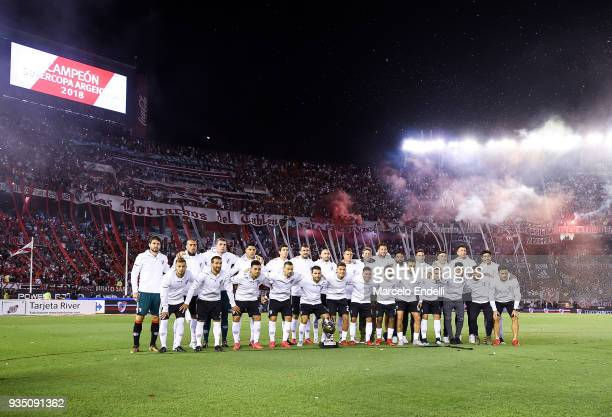 Players of River Plate pose with the Supercopa Trophy before a match between River Plate and Belgrano as part of Superliga 2017/18 at Monumental...