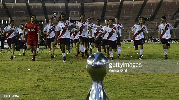 Players of River Plate run towards the trophy after a final match between River Plate and Rosario Central as part of Copa Argentina 2016 at Mario...