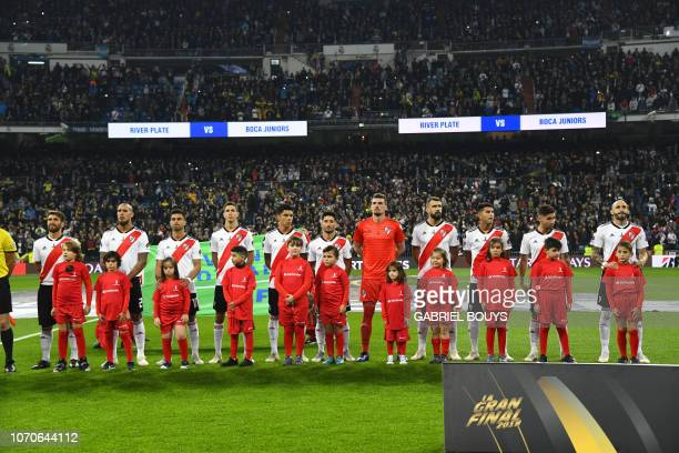 Players of River Plate stand before the start of their second leg match of the allArgentine Copa Libertadores final against Boca Juniors at the...