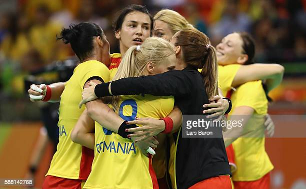 Players of Romania celebrate after winning the Womens Preliminary Group A match between Romania and Montenegro at Future Arena on August 10, 2016 in...