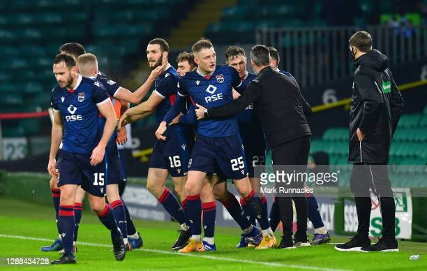 Players of Ross County celebrates after Alex Iacovitti of Ross County scored their sides second goal during the Betfred Cup match between Celtic and...