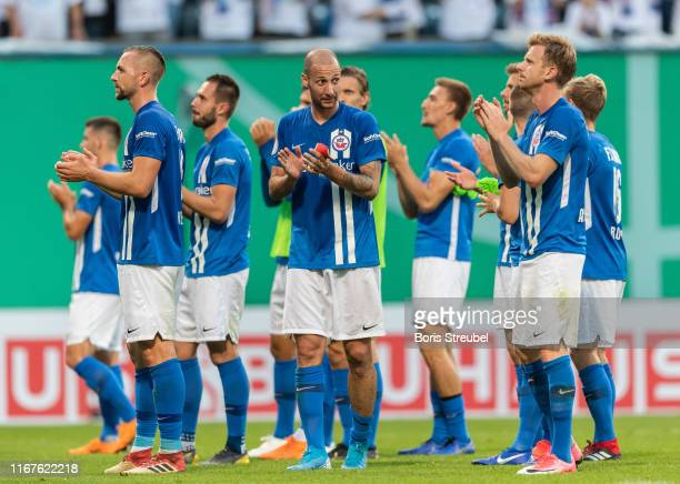 Players of Rostock applaud their fans after the DFB Cup first round match between Hansa Rostock and VfB Stuttgart at Ostseestadion on August 12 2019...