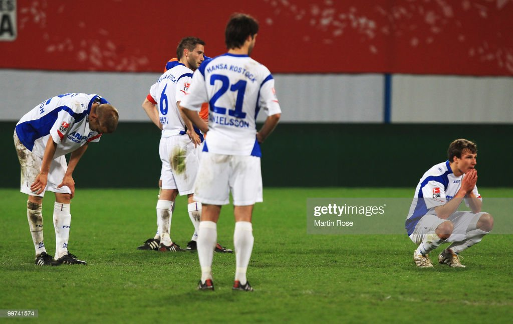 Players of Rostock look dejected after the Second Bundesliga play off leg two match between Hansa Rostock and FC Ingolstadt 04 at DKB Arena on May 17, 2010 in Rostock, Germany. Hansa Rostock go down to the Third Bundesliga.
