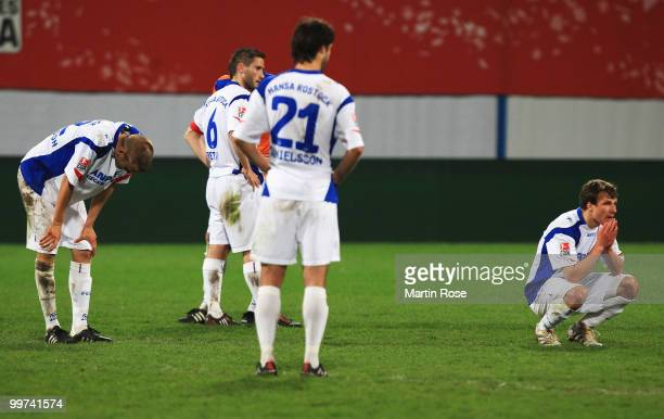 Players of Rostock look dejected after the Second Bundesliga play off leg two match between Hansa Rostock and FC Ingolstadt 04 at DKB Arena on May 17...