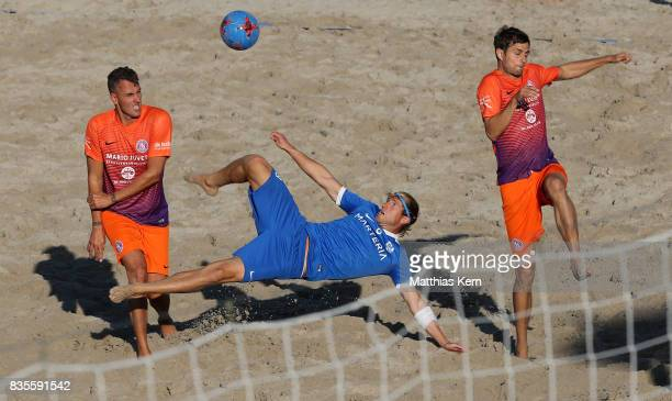 Players of Rostocker Robben and Wuppertaler SV battle for the ball on day 1 of the 2017 German Beach Soccer Championship on August 19 2017 in...