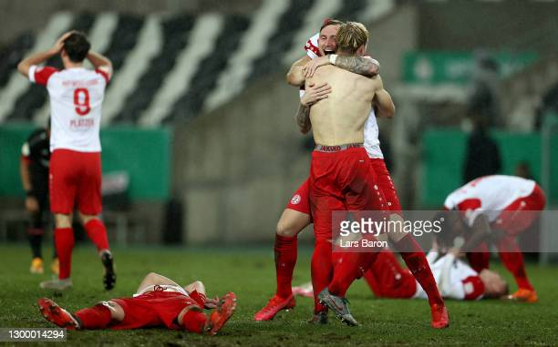 Players of Rot-Weiss Essen celebrate following their sides victory after the DFB Cup Round of Sixteen match between Rot-Weiss Essen and Bayer...