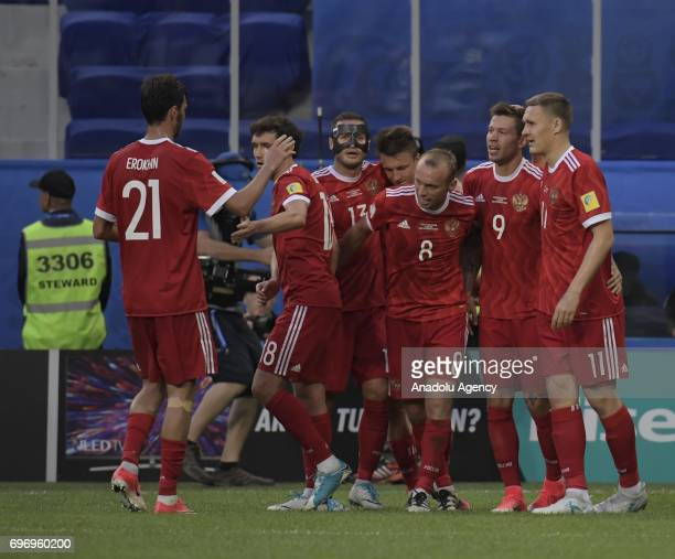 Players of Russia celebrate after scoring a goal during the Confederations Cup 2017 opening match between Russia and New Zealand at SaintPetersburg...