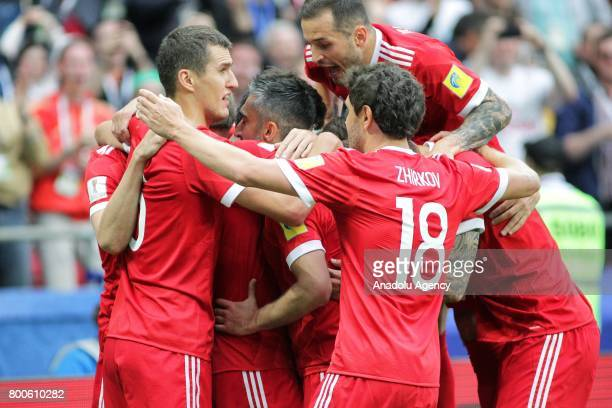 Players of Russia celebrate after scoring a goal during the FIFA Confederations Cup 2017 group A soccer match between Mexico and Russia at 'Kazan...