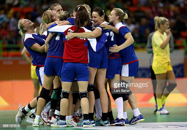 Players of Russia celebrate after winning the Womens Preliminary Group B match between Russia and Sweden at Future Arena on August 10, 2016 in Rio de...