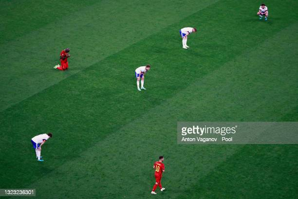 Players of Russia look dejected whilst Romelu Lukaku of Belgium celebrates their side's victory after the UEFA Euro 2020 Championship Group B match...