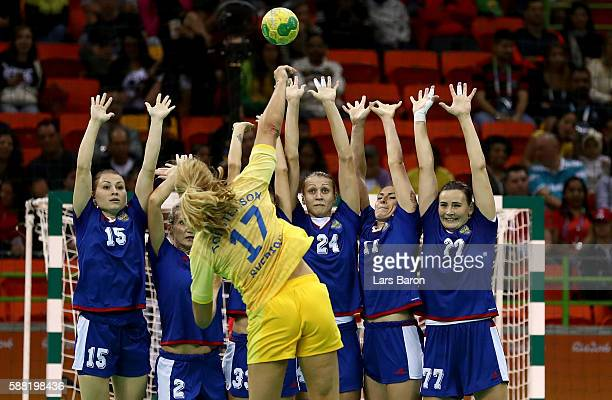 Players of Russia try to block the shot of Linnea Torstensson of Sweden during the Womens Preliminary Group B match between Russia and Sweden at...