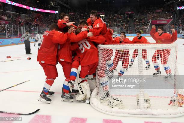Players of Russian Federation celebrate after winning the Men's 6-Team Ice Hockey Tournament Finals Gold Medal Game between Russian Federation and...