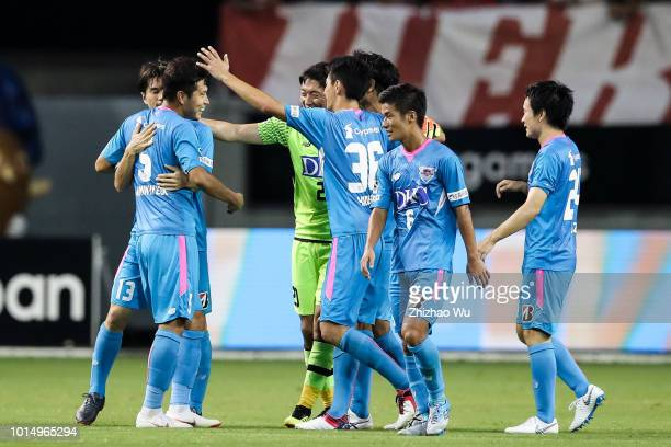Players of Sagan Tosu celebrate after the J.League J1 match between Sagan Tosu and Urawa Red Diamonds at Best Amenity Stadium on August 11, 2018 in...
