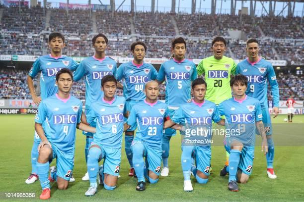 Players of Sagan Tosu line up for team photos prior to the J.League J1 match between Sagan Tosu and Urawa Red Diamonds at Best Amenity Stadium on...