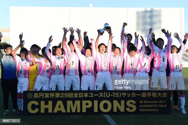 Players of Sagan Tosu U15 celebrate their victory as captain Hikaru Suetsugi lifts the trophy after the Prince Takamado Cup 29th All Japan Youth...