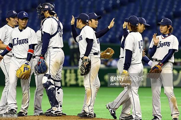 Players of Saitama Seibu Lions celebrate victory after a friendly match between China and Saitama Seibu Lions at Tokyo Dome on March 1 2009 in Tokyo...