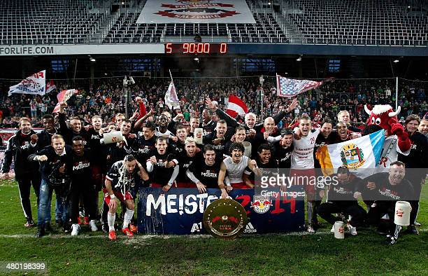 Players of Salzburg celebrate with the trophy after winning the tipp3 Bundesliga match between Red Bull Salzburg and SC Wiener Neustadt at Red Bull...