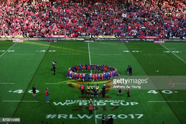 Players of Samoa and Tonga pray prior to the 2017 Rugby League World Cup match between Samoa and Tonga at Waikato Stadium on November 4 2017 in...