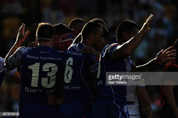 Players of Samoa celebrate a try by Isaac Liu of Samoa during the Four Nations match between England and Samoa at Suncorp Stadium on October 25 2014...