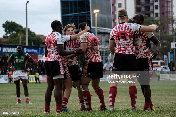 Players of Samurai RFC celebrate after winning the final match against Kenya's national team Shujaa during the final of Safari Sevens Kenya's annual...