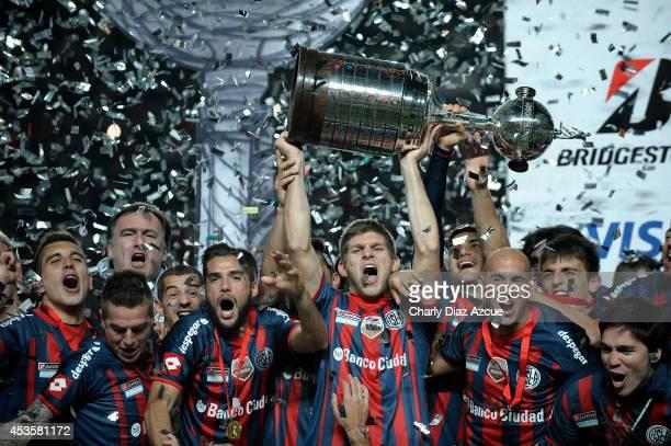 Players of San Lorenzo celebrate winning the Copa Libertadores after the second leg final match between San Lorenzo and Nacional as part of Copa...