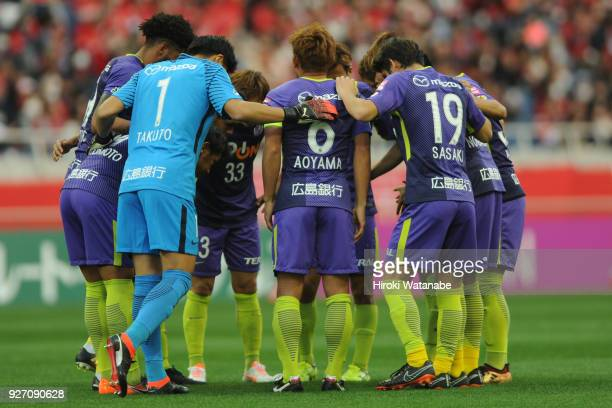 Players of Sanfrecce Hiroshima hud dle during the JLeague J1 match between Urawa Red Diamonds and Sanfrecce Hiroshima at Saitama Stadium on March 4...