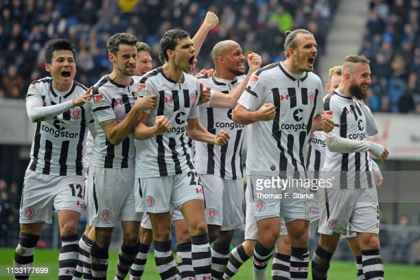 Players of Sankt Pauli celebrate with Alexander Meier who scored his teams first goal during the Second Bundesliga match between SC Paderborn 07 and...