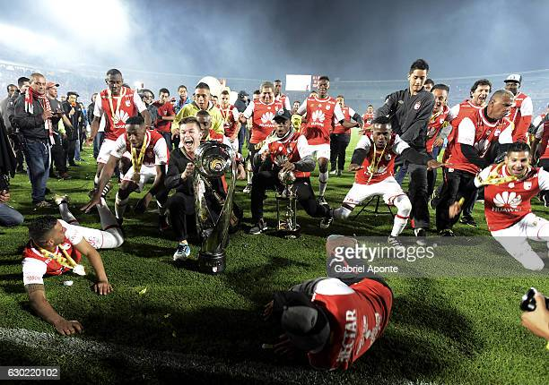 Players of Santa Fe celebrate with the trophy after a second leg final match between Santa Fe and Deportes Tolima as part of Liga Aguila II 2016 at...