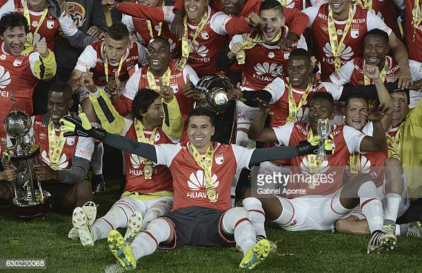 Players of Santa Fe pose for a photo to celebrate with the trophy after winning the Liga Aguila II 2016 tournament after a second leg final match...