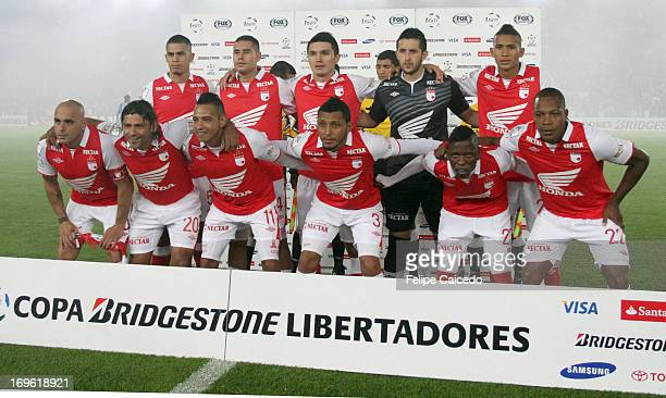 Players of Santa fe pose for a team photo prior to a match between Santa Fe and Real Garcilaso as part of The Copa Bridgestone Libertadores 2013 at...