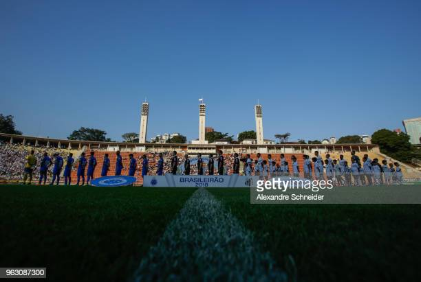 Players of Santos and of Cruzeiro stand for the national anthen before the match between Santos and Cruzeiro for the Brasileirao Series A 2018 at...