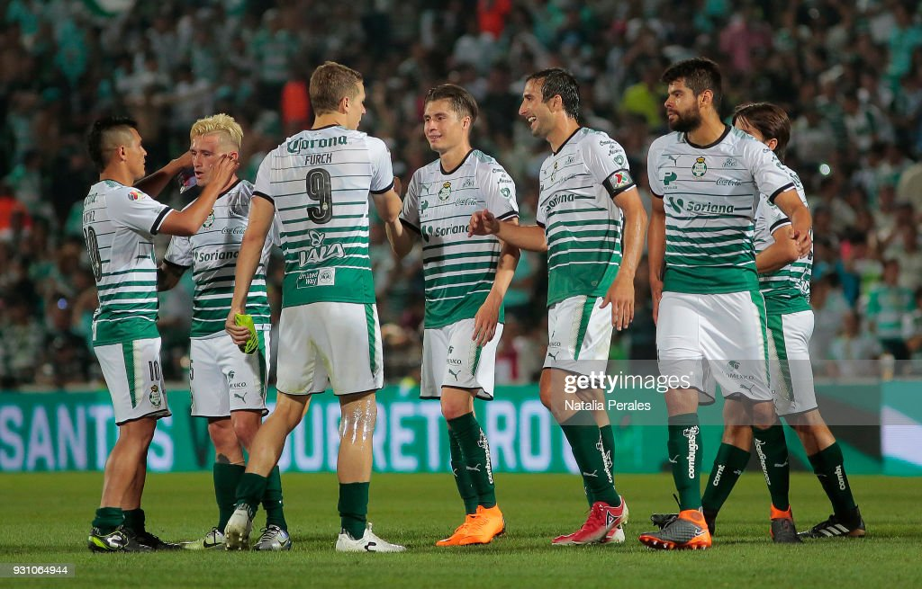 Players of Santos celebrate after the 11th round match between Santos Laguna and Monterrey as part of the Torneo Clausura 2018 Liga MX at Corona Stadium on March 11, 2018 in Torreon, Mexico.