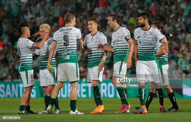 Players of Santos celebrate after the 11th round match between Santos Laguna and Monterrey as part of the Torneo Clausura 2018 Liga MX at Corona...