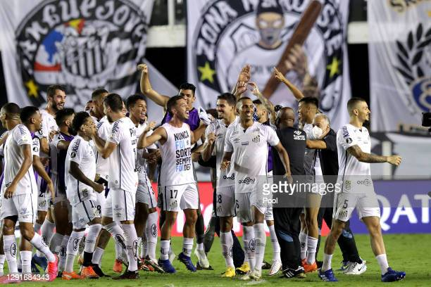 Players of Santos celebrate the victory after a quarter final second leg match between Santos and Gremio as part of Copa CONMEBOL Libertadores 2020...