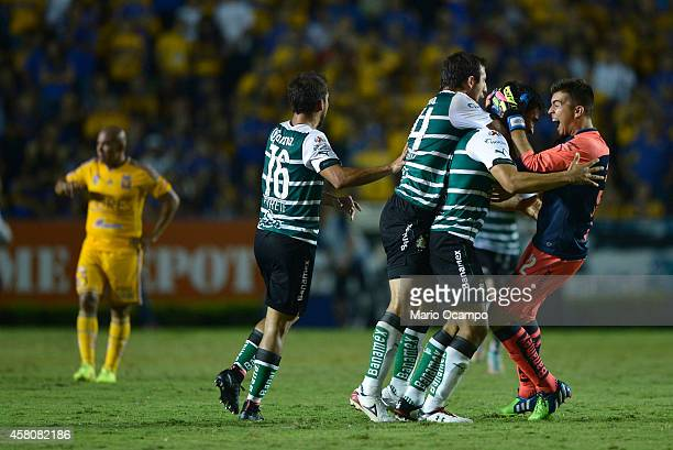 Players of Santos celebrate their third goal scored by Oswaldo Alanis during a semifinal match between Tigres UANL and Santos Laguna as part of Copa...