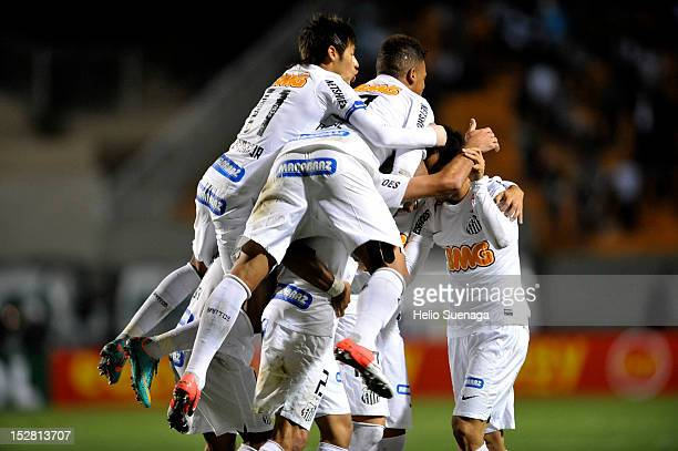 Players of Santos celebrates a scored goal during a match between Santos and Universidad de Chile as part of the Recopa Sudamericana 2012 at Pacaembu...