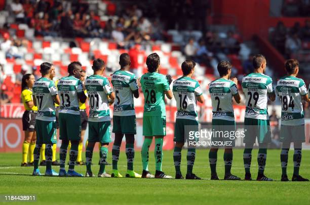 Players of Santos clap their hands for a minute in honor to Jorge Vergara before the match against Toluca before their Mexican Apertura 2019...