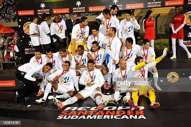 Players of Santos pose for a team photo after win the second leg of the final of the Recopa Sudamericana 2012 between Santos and Universidad do Chile...