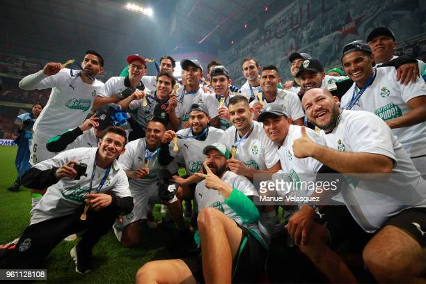 Players of Santos pose with the Championship Trophy after the Final second leg match between Toluca and Santos Laguna as part of the Torneo Clausura...