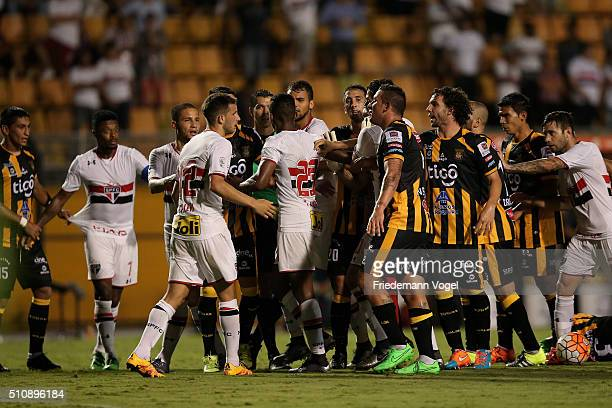 Players of Sao Paulo and The Strongest fights during a match between Sao Paulo v The Strongest as part of Group 1 of Copa Bridgestone Libertadores at...