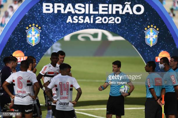 Players of Sao Paulo talk to the referees before the game between Sao Paulo and Goias as part of the 2020 Brasileirao Series A being postponed and...
