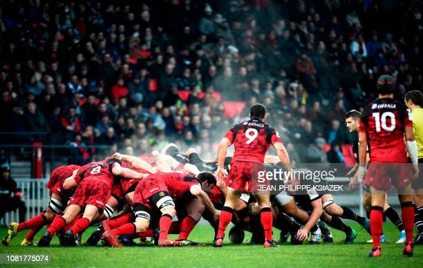 TOPSHOT Players of Saracens and Lyon fight for the ball in a scrum during the European Champions Cup rugby union pool match between Lyon and Saracens...