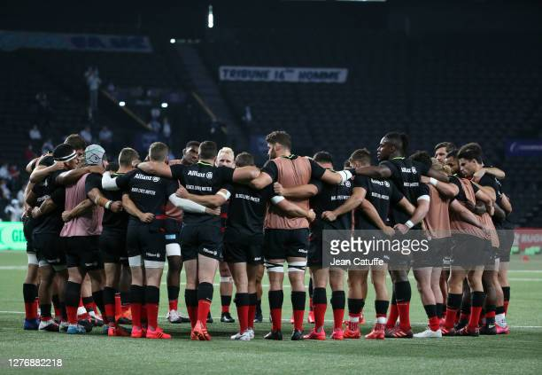 Players of Saracens gather before the Heineken Champions Cup Semi Final match between Racing 92 and Saracens at Paris La Defense Arena on September...