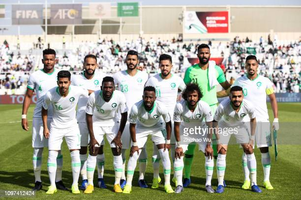 Players of Saudi Arabia line up for team photos prior to the AFC Asian Cup round of 16 match between Japan and Saudi Arabia at Sharjah Stadium on...